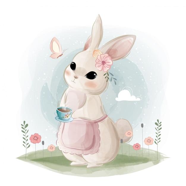 Cute bunny holding a tea cup Premium Vector