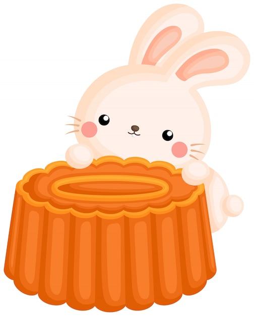 Милый зайчик на лунном пироге Premium векторы