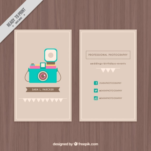 Cute business card with an illustrated camera Free Vector