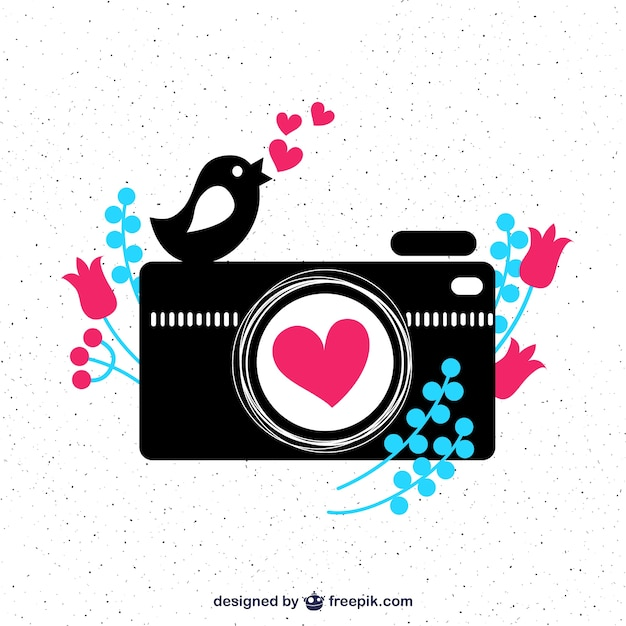 Cute camera and a bird Free Vector