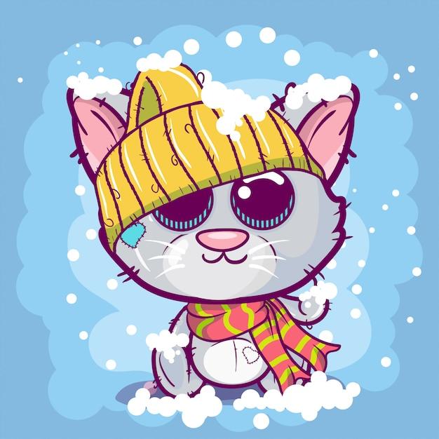 Cute cartoon kitten on a snow background. Premium Vector