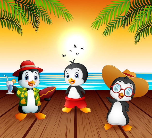 Cute cartoon penguins in summer holiday Premium Vector