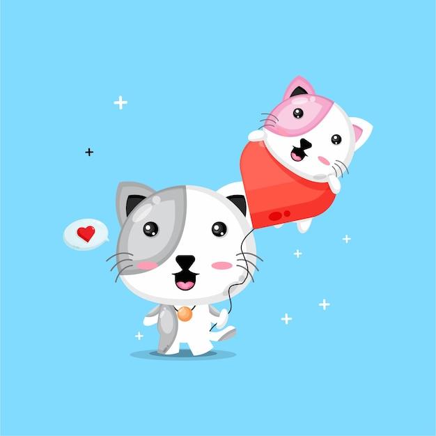 사랑 풍선을 들고 귀여운 고양이 프리미엄 벡터