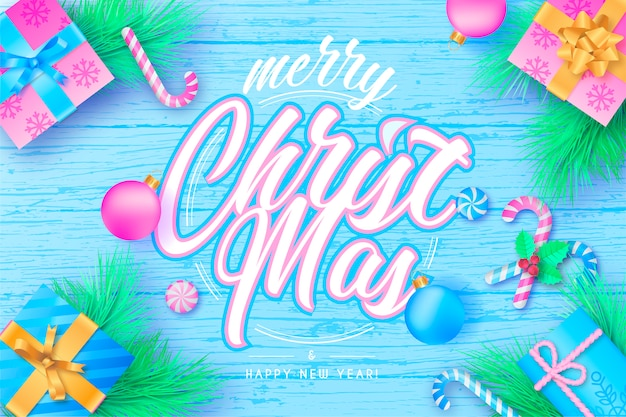 Cute christmas background with lettering in pastel colors Free Vector