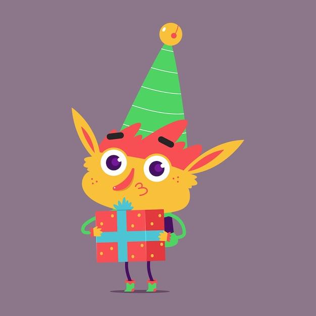 背景に分離されたギフトボックスの漫画のキャラクターとかわいいクリスマスエルフ Premiumベクター