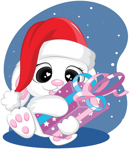 Cute christmas rabbit with with gift and santa hat merry xmas and new year cartoon Premium Vector