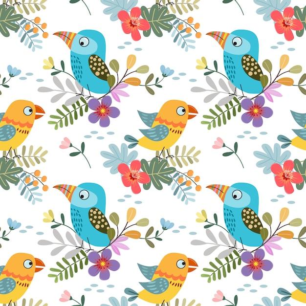 熱帯の葉のシームレスパターン生地繊維とかわいいカラフルな鳥。 Premiumベクター