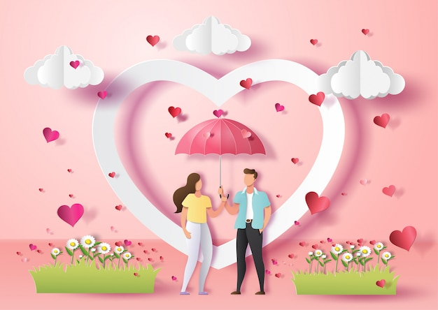 Cute couple in love holding umbrella with many hearts . Premium Vector