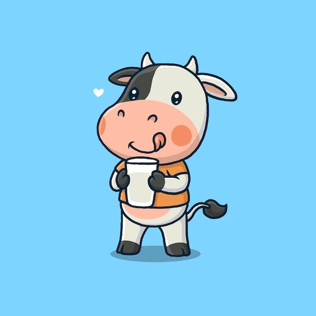 青で隔離の牛乳のガラスを保持しているかわいい牛 Premiumベクター