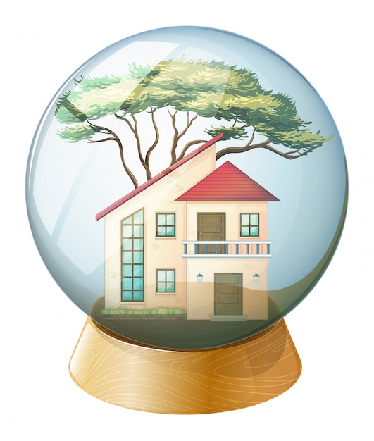 A cute crystal ball with a big house inside Free Vector