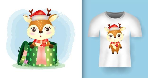 Tシャツデザインのギフトボックスにサンタの帽子とスカーフを使用したかわいい鹿クリスマスキャラクター Premiumベクター