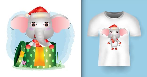 Tシャツデザインのギフトボックスでサンタ帽子とスカーフを使用してかわいい象のクリスマスキャラクター Premiumベクター