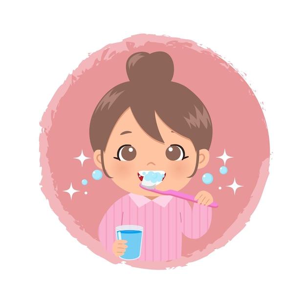 물 한 잔을 들고 칫솔로 그녀의 이빨을 닦고 귀여운 소녀 프리미엄 벡터