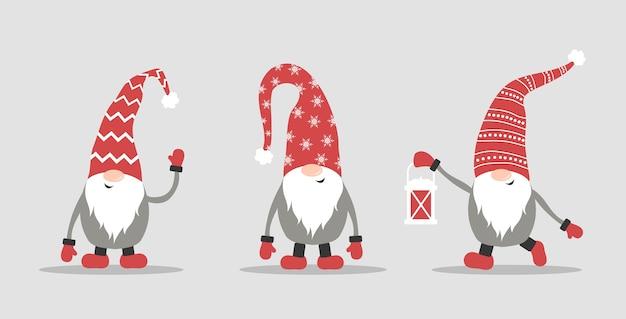 白い背景の上の赤いサンタ帽子のかわいいノーム。スカンジナビアのクリスマスエルフ。 Premiumベクター
