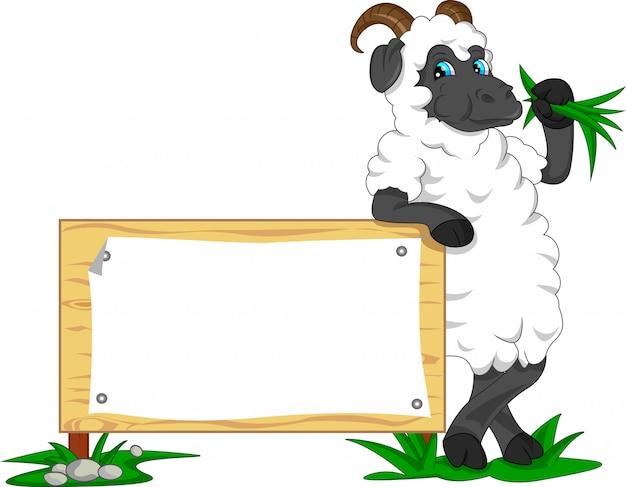 Cute goat cartoon with blank sign Premium Vector