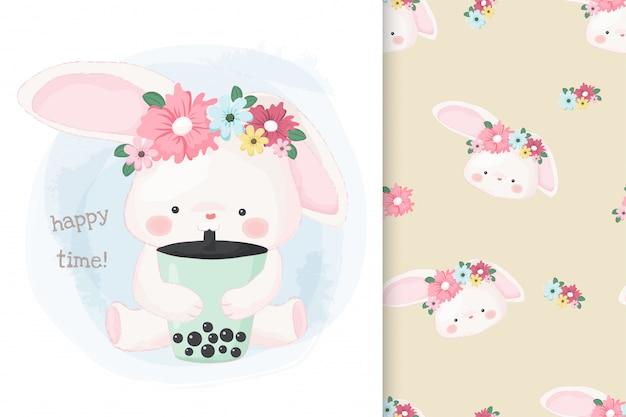 Cute hand drawn bunny drinking bubble milk tea with pattern Premium Vector