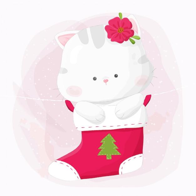 Cute hand drawn kitty cat hanging in christmas stocking. Premium Vector