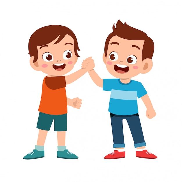 Cute happy kid doing hand shake with friend Premium Vector