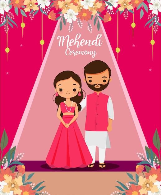 結婚式の日にmehendi式のピンクの伝統的なドレスでかわいいインドのカップル Premiumベクター