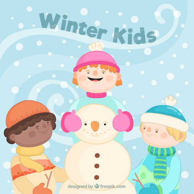Cute kids making a snowman outdoors