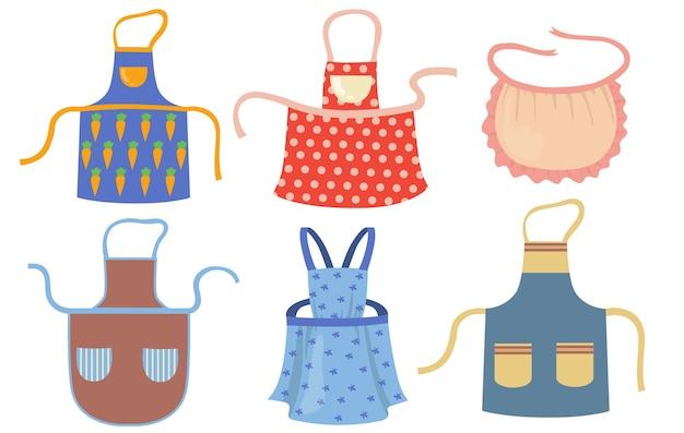 Симпатичные кухонные фартуки с узорами плоский набор. мультфильм готовя платье для домохозяйки или шеф-повара ресторана изолировал коллекцию векторных иллюстраций. защитная одежда и концепция домашнего хозяйства Бесплатные векторы