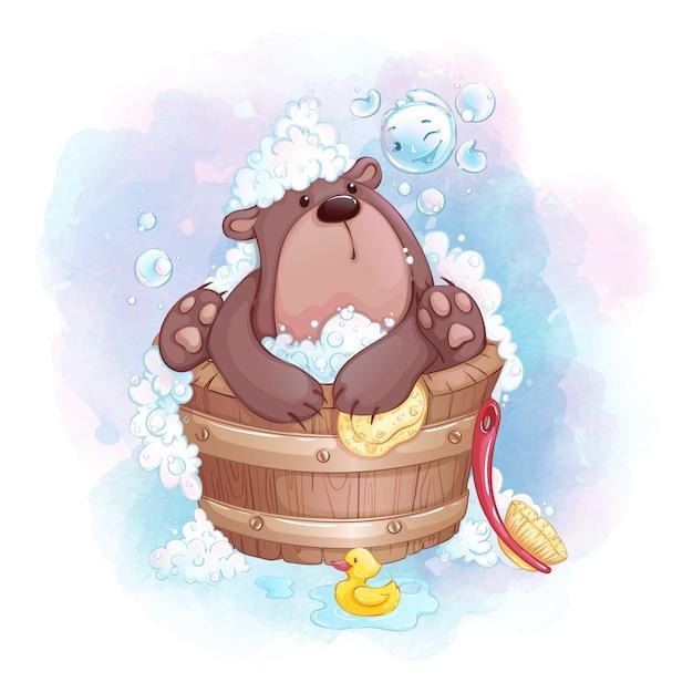 Милый маленький медведь купается в деревянной ванне и играет с мыльными пузырями. Premium векторы