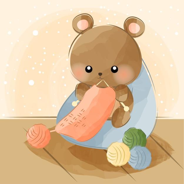 Cute little bear knitting Premium Vector