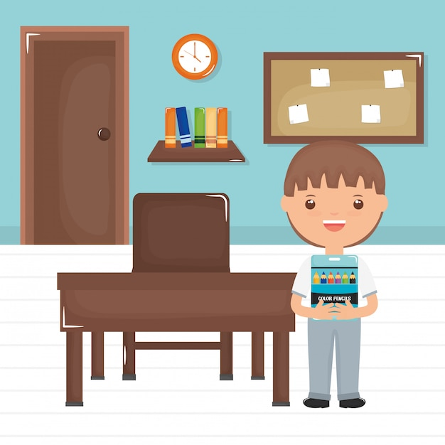 Cute little student boy in the classroom Free Vector