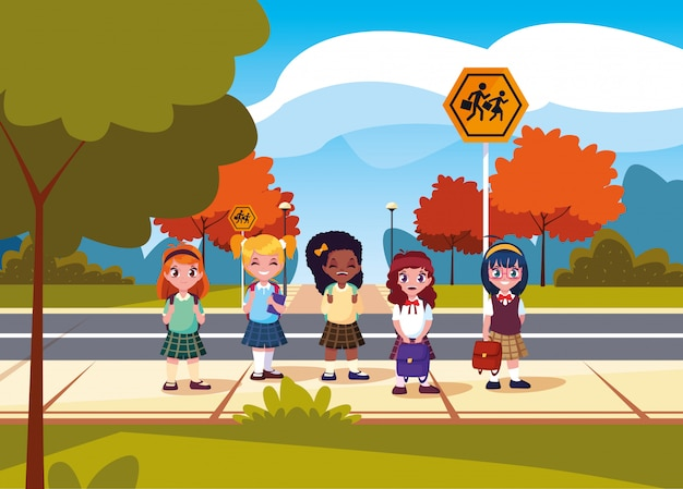 Cute little students girls in road Premium Vector