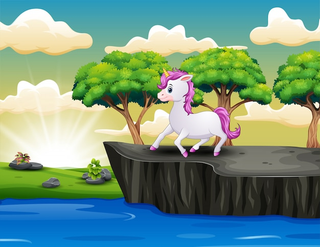 Cute little unicorn on the cliff Premium Vector