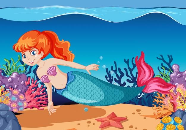 海の背景の下にかわいい人魚の漫画のキャラクターの漫画のスタイル 無料ベクター
