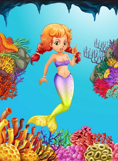 Cute mermaid swimming under the ocean Premium Vector