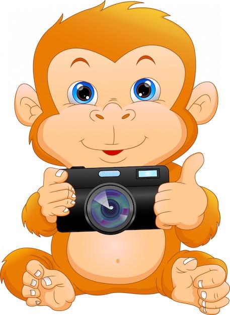 かわいい猿漫画カメラを保持 Premiumベクター
