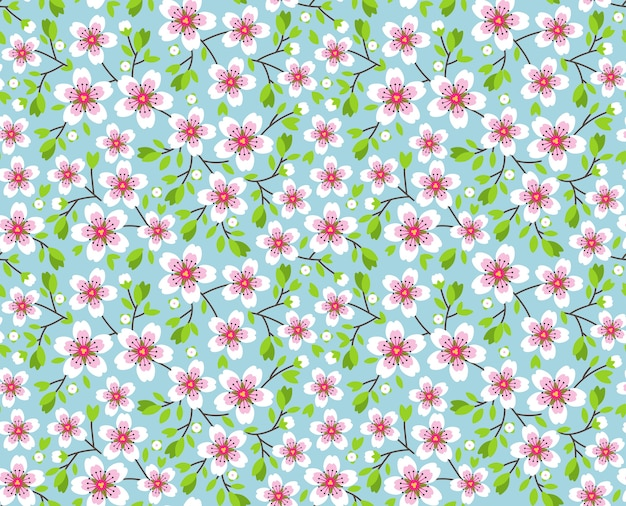 Cute pattern in small flower. pink sakura flowers, blossoming japanese cherry. symbol of spring.  small colorful flowers. blue background. floral seamless pattern. small cute simple spring flowers. Premium Vector