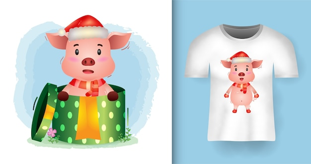 Tシャツデザインのギフトボックスにサンタの帽子とスカーフを使用したかわいいブタのクリスマスキャラクター Premiumベクター