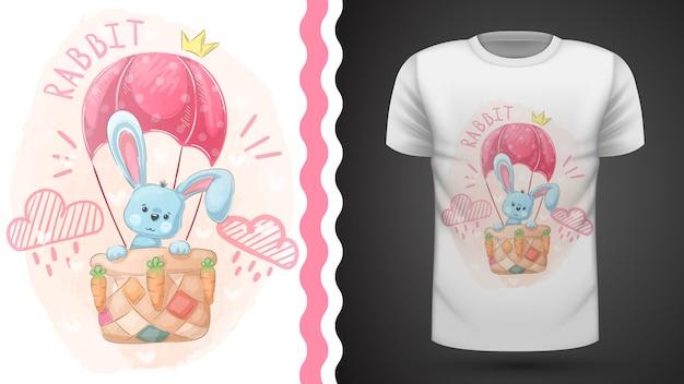 Cute rabbit and air balloon - idea for print t-shirt. Premium Vector