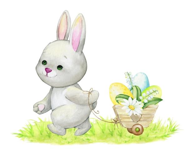 かわいいウサギは、カート、イースターエッグのバスケットで運ばれています。子供のイラストのための、孤立した背景の水彩画の概念 Premiumベクター