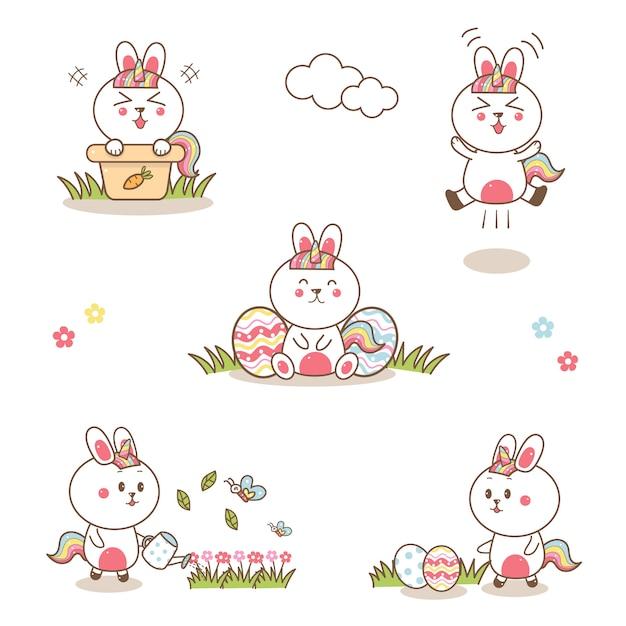 Симпатичные кролик единорог мультфильм рисованной с пастельные цвета на пасху. Premium векторы