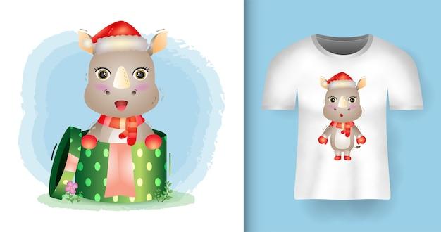 Tシャツデザインのギフトボックスでサンタ帽子とスカーフを使用したかわいいサイのクリスマスキャラクター Premiumベクター