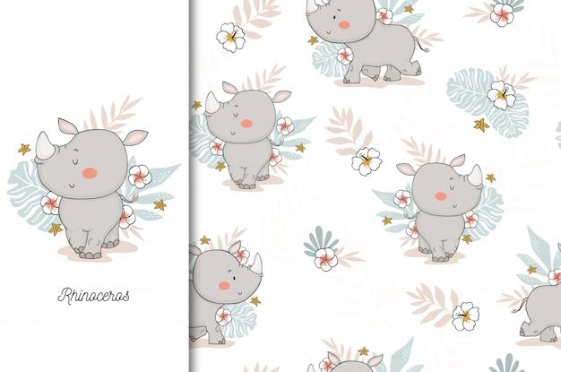 Cute rhinoceros baby. jungle animal cartoon character and seamless pattern Premium Vector