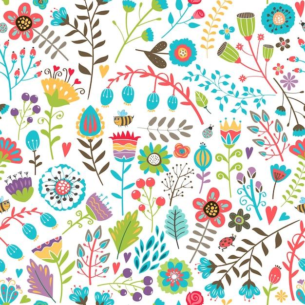 Simpatico motivo senza cuciture con fiori estivi colorati disegnati a mano sparsi in modo casuale in un design impegnato adatto per carta da parati e tessuto Vettore gratuito