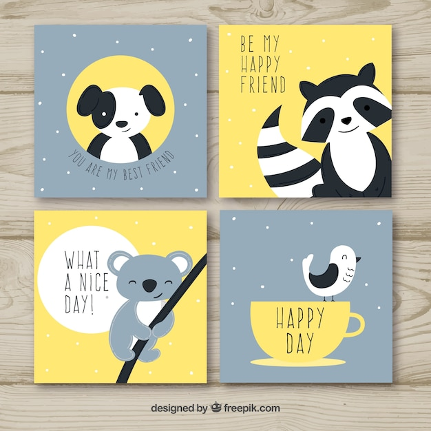 Cute set of cards with happy animals Free Vector