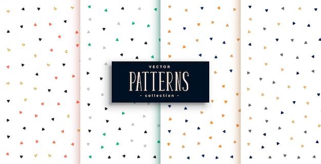 흰색 배경 세트에 귀여운 작은 삼각형 패턴 무료 벡터