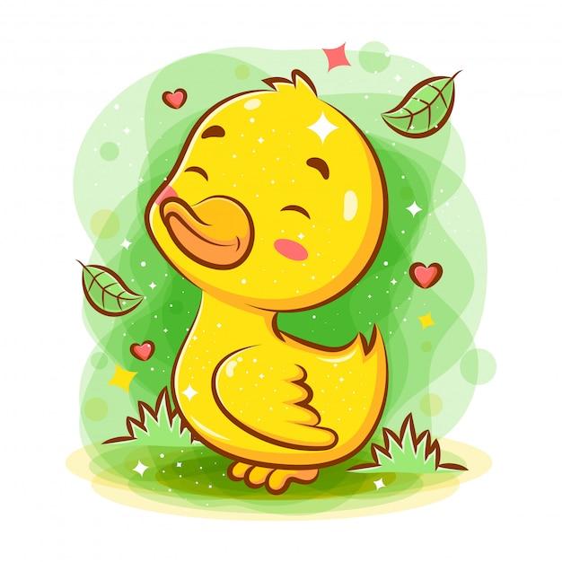 庭で遊ぶかわいいスマイリー赤ちゃんアヒル Premiumベクター
