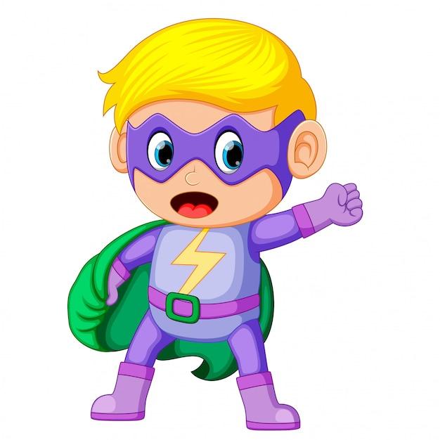 Cute smiling child boy in superhero costume Premium Vector