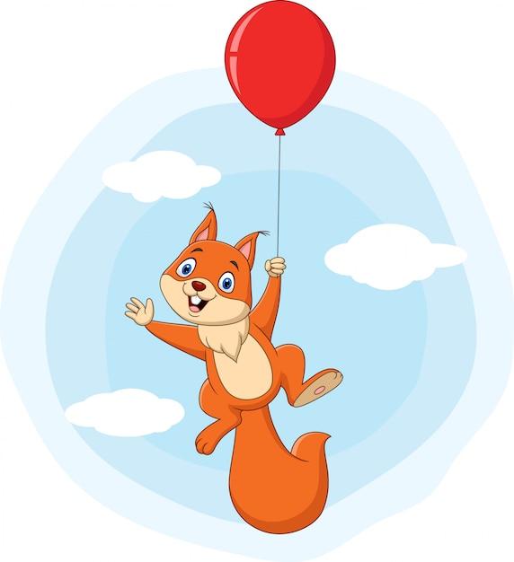 Милый мультфильм белка летит с воздушным шаром Premium векторы
