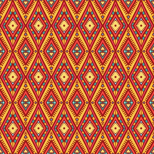 ひし形のかわいい部族オレンジとピンクのシームレスパターン Premiumベクター