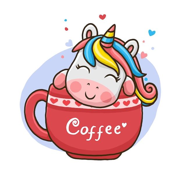 Милый единорог в чашке кофе, изолированные на белом фоне. Premium векторы