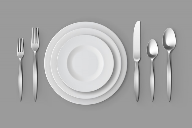 カトラリーシルバーフォークスプーンとナイフプレートテーブルの設定 Premiumベクター