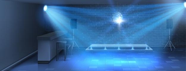 Dance floor with empty stage in nightclub Free Vector